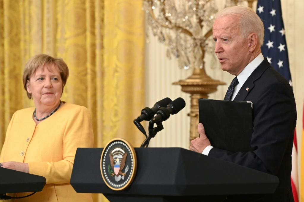 US President Joe Biden and German Chancellor Angela Merkel hold a joint press conference in the East Room of the White House