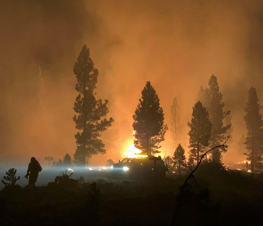 A firefighter and rig during night operations on the night of July 17 at the Bootleg Fire, near Klamath Falls, Oregon