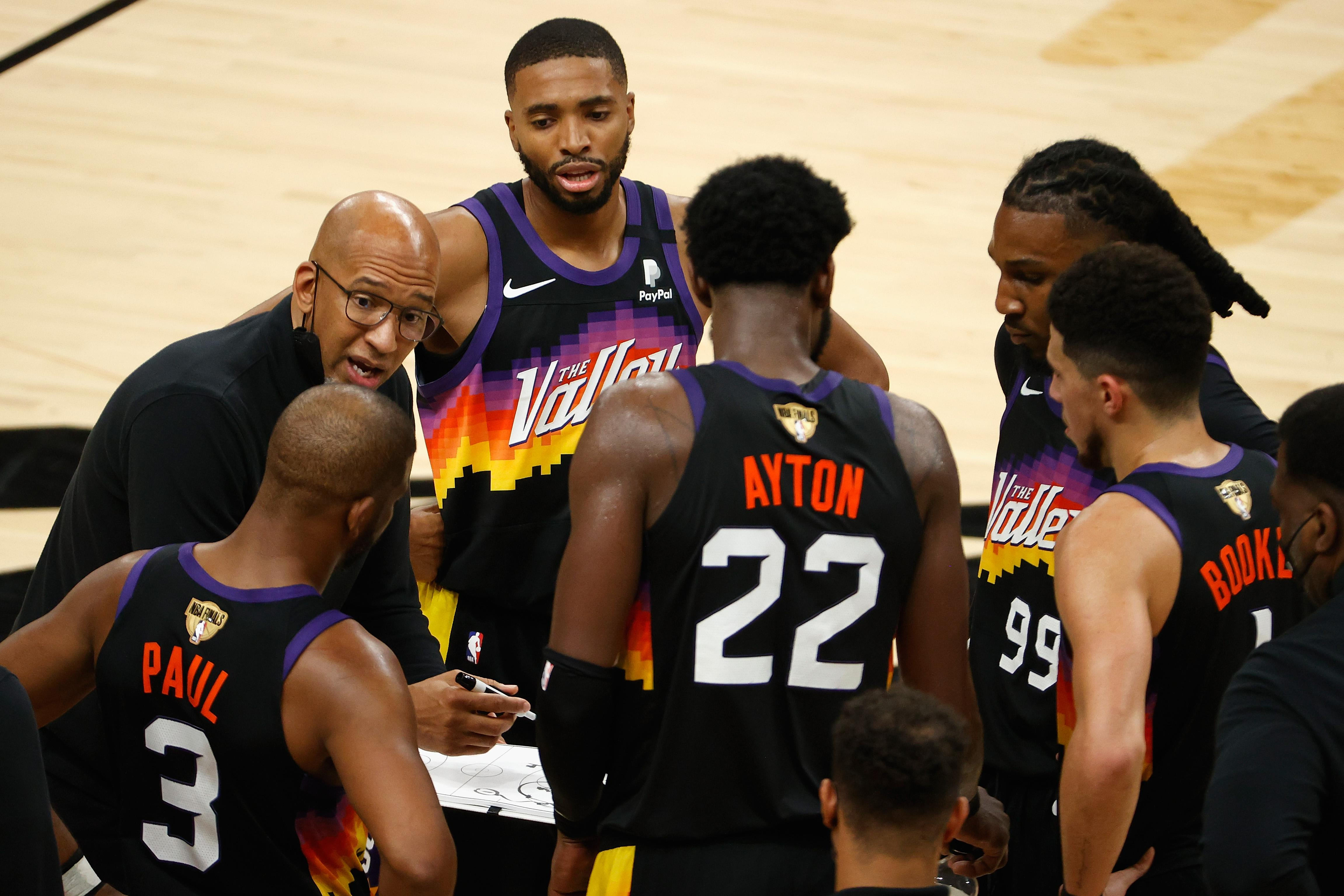 Phoenix Suns head coach Monty Williams giving instructions to his players.
