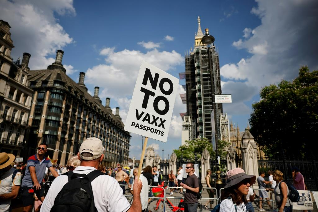 Anti-vaccination protesters gather outside the Houses of Parliament as coronavirus restrictions are lifted in England. But scientists expressed deep concern as infections. Britain will administer vaccines to clinically vulnerable youngsters.