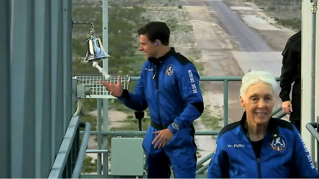 Dutch teen Oliver Daemen (L) and pioneering aviator Wally Funk (R) joined Jeff bezos and his brother Mark on the mission