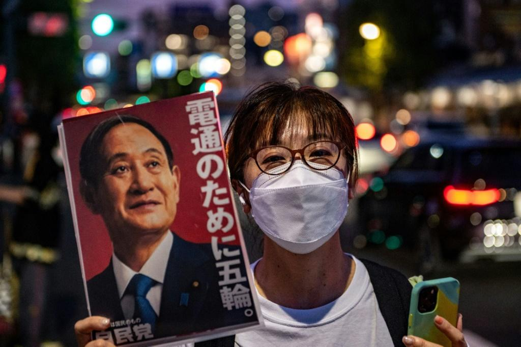 Japan's Prime Minister Yoshihide Suga has denied he was pressured by the International Olympic Committee into holding a Games that remains deeply unpopular