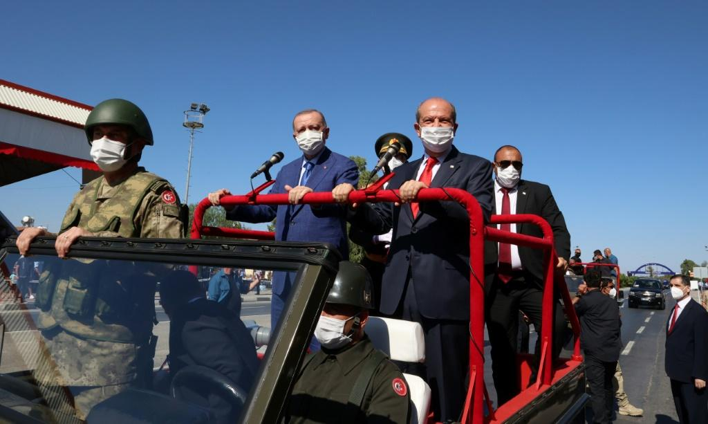 Turkish Cypriot leader Ersin Tatar (right) and Turkish President Recep Tayyip Erdogan (left) take part in a parade in the northern part of Cyprus' divided capital Nicosia