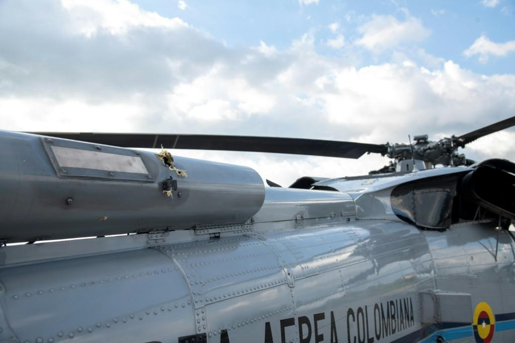A handout picture released by the Colombian Presidency shows bullet holes in the presidential helicopter at the Camilo Daza International Airport in Cucuta, Colombia on June 25, 2021