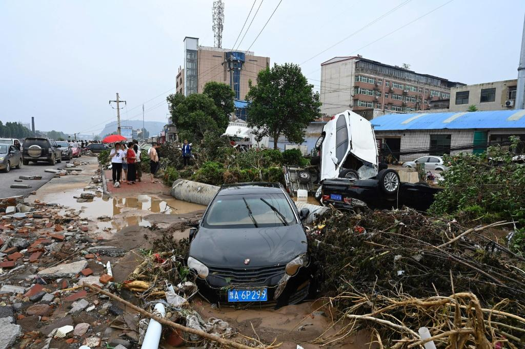 Devastated locals surveyed the damage as the rains finally subsided