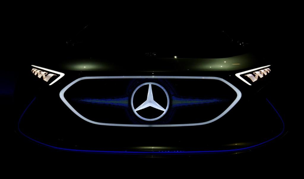 (FILES) In this file photo taken on April 05, 2018 a Mercedes logo appears on a EQA electric concept car during German luxury car manufacturer Daimler's annual general meeting in Berlin.German luxury carmaker Daimler said on July 22, 2021 it was investing