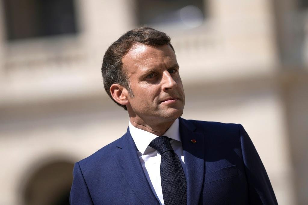 French President Emmanuel Macron's meetings in Tokyo will include talks with IOC chief Thomas Bach
