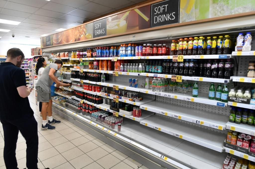 Newspapers ran photos of empty supermarket shelves as missing staff at stores as well as in supply chains hit retailer's operations