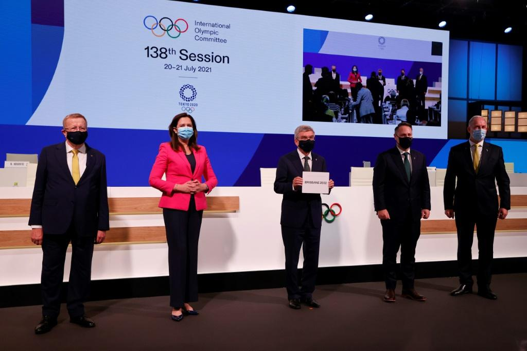 President of the International Olympic Committee (IOC) Thomas Bach (C) poses with members of the Brisbane 2032 delegation (L-R) President of Australian Olympic Committee John Coates, Queensland Premier Annastacia Palaszczuk