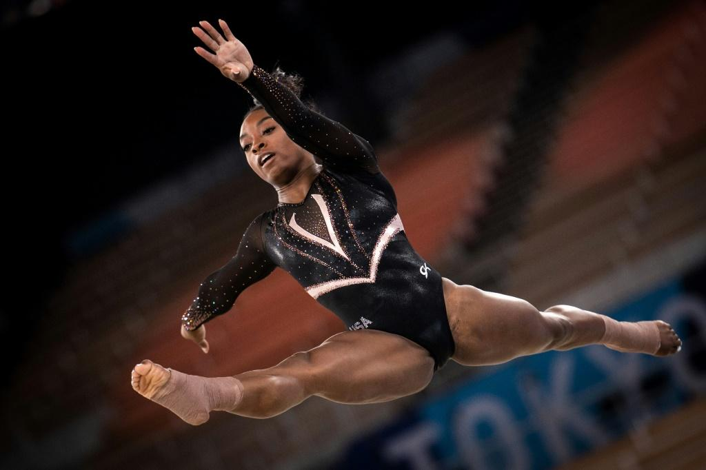 Reigning Olympic gymnastics champion Simone Biles warms up for the defence of her crown in Tokyo