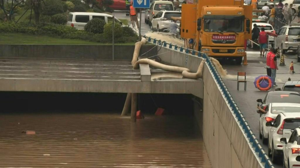 Water is being pumped out of a flooded tunnel in the central Chinese city of Zhengzhou after record rainfall caused deadly floods.