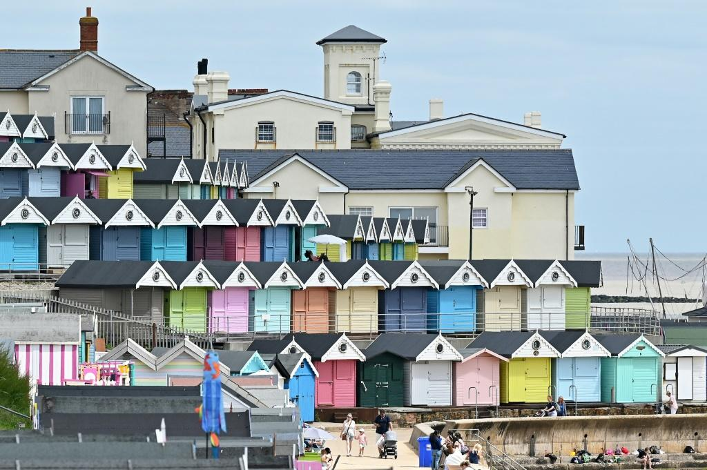 Brightly painted wooden beach huts along England's coastline have enjoyed a boom during the pandemic