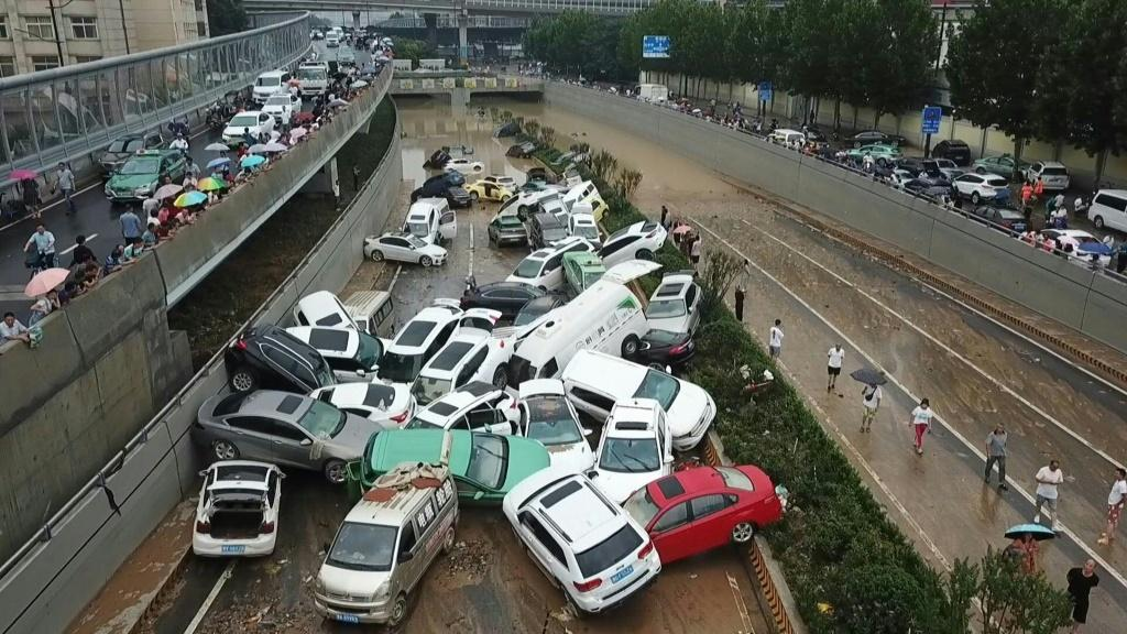 Drone images show a pile of vehicles swept away by floods, blocking a highway in central China's Zhengzhou. Torrential rains hit the city, leading to at least 25 deaths and millions of dollars in damages.