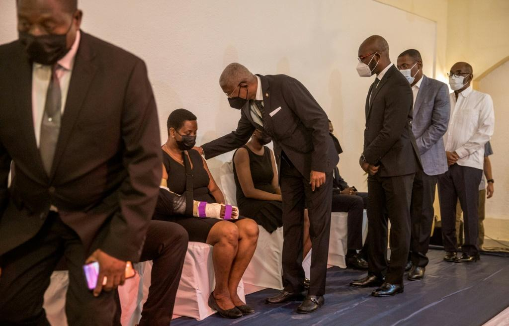 Family members and friends offer condolences to Martine Moise, the widow of slain president Jovenel Moise, and her children during a Catholic Mass in Cap-Haitien