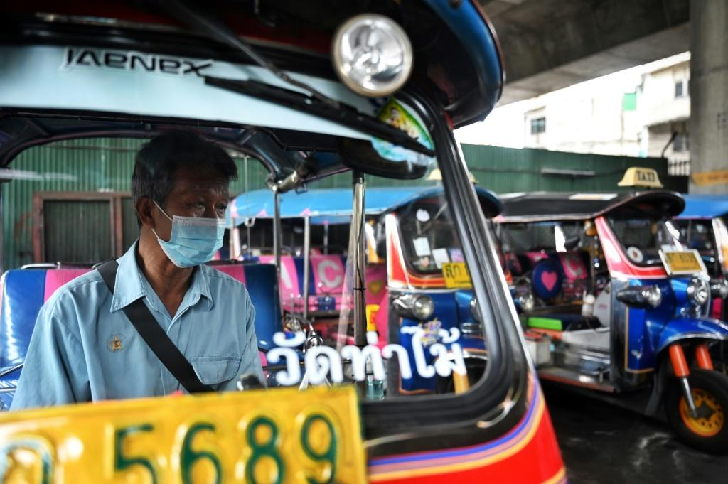 """I feel hopeless but I still have to fight for the survival of my family,"""" says tuk-tuk driver Somsak Boontook"""