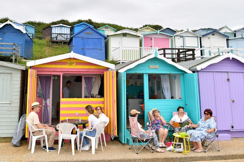 In the eastern English resort of Walton-on-the-Naze, beach huts run along the shore for miles