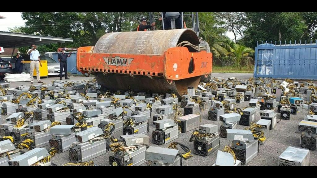 Malaysian police have hit on a novel way to dispose of more than 1,000 bitcoin-mining machines seized in raids -- crushing the devices using a steamroller.
