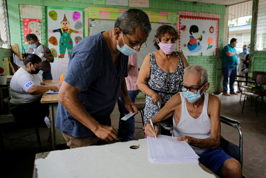 A man checks his identification on the voting list during the citizen verification process in Managua, Nicaragua