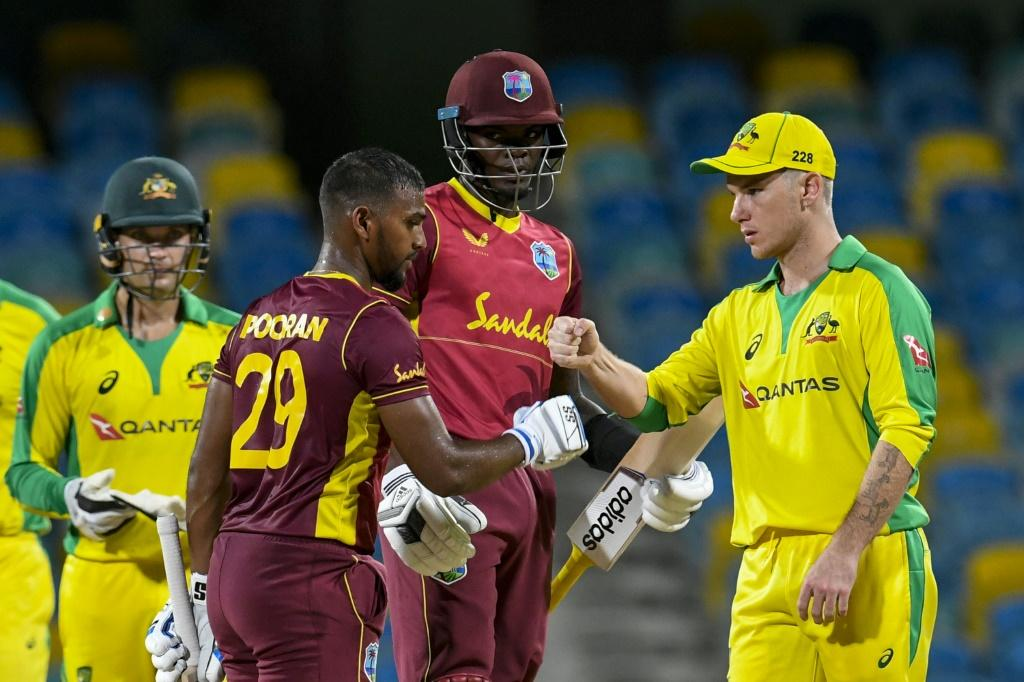 Nicholas Pooran and Alzarri Joseph of West Indies are congratulated by Adam Zampa (right) of Australia for winning the 2nd ODI between West Indies and Australia at Kensington Oval, Bridgetown, Barbados