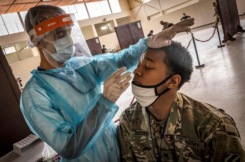 A US army soldier is tested for Covid-19 upon arrival at Morocco's Agadir military airport in June 2021 amid ongoing restrictions on travel due to the pandemic