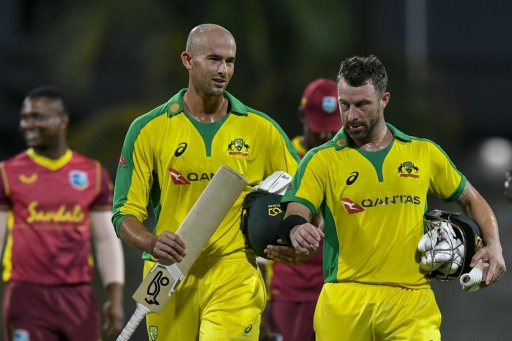 Ashton Agar (left) and Matthew Wade of Australia chat after winning the 3rd and final ODI between West Indies and Australia at Kensington Oval, Bridgetown, Barbados