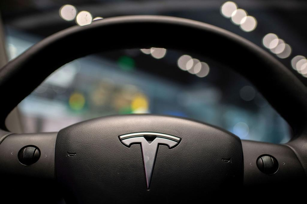 Tesla reported its first quarterly profit above $1 billion on record auto deliveries