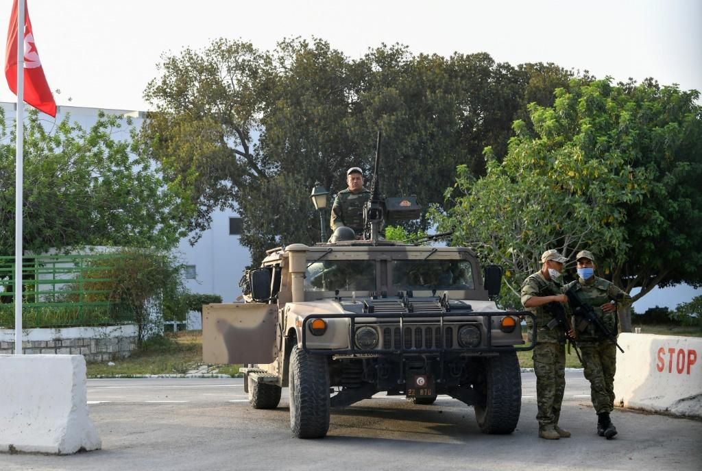 Tunisian soldiers cordon-off parliament in the capital Tunis on Monday, following the president's dismissal of the prime minister and suspension of parliament