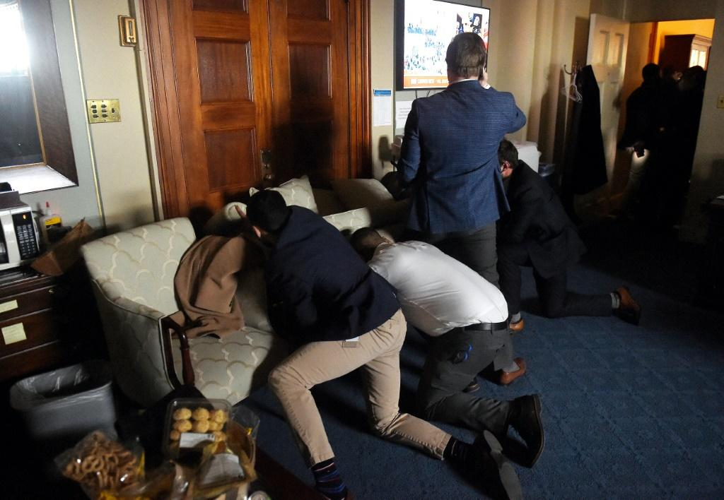 Congress staffers barricade themselves after Trump supporters stormed inside the US Capitol in Washington, DC on January 6, 2021