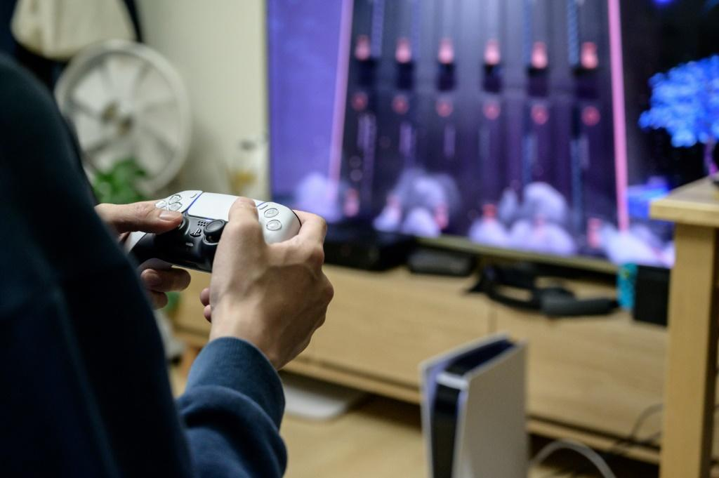 A gamer plays on the new Sony Playstation PS5 at his home in Seoul in November 2020 shortly after the coveted console was launched