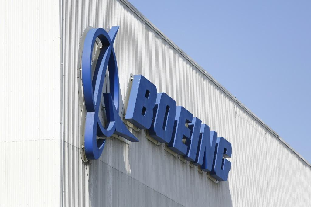 Boeing shares surged after it reported a surprise profit and said it would cut fewer jobs than previously expected