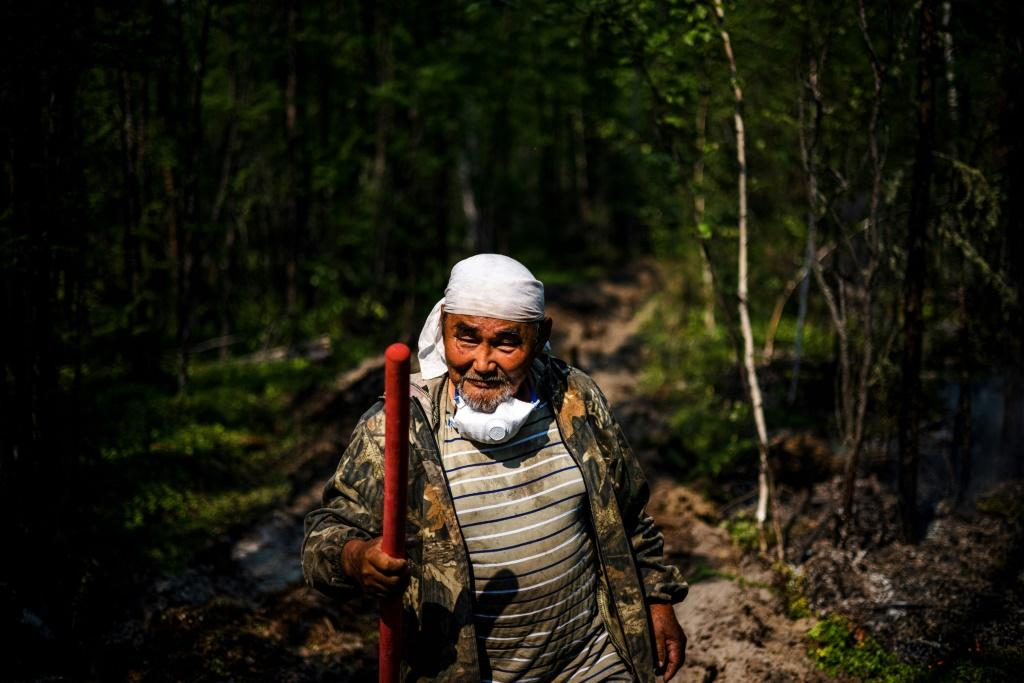 """I've lived my whole life in the taiga. I'm dependent on nature,"""" 65-year-old Ivan Fyodorov says as he helps fight a fire near his land. """"We have to protect it."""