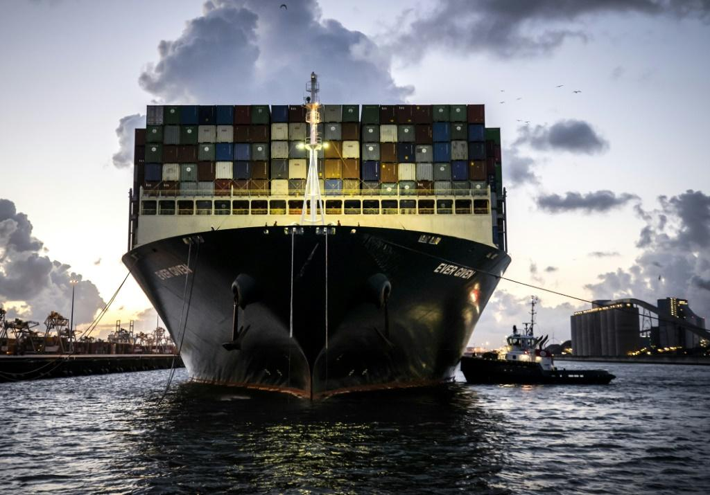 The container ship Ever Given, seen here arriving in the port of Rotterdam on Thursday, was wedged in the Suez Canal for six days, blocking traffic through the key shipping route
