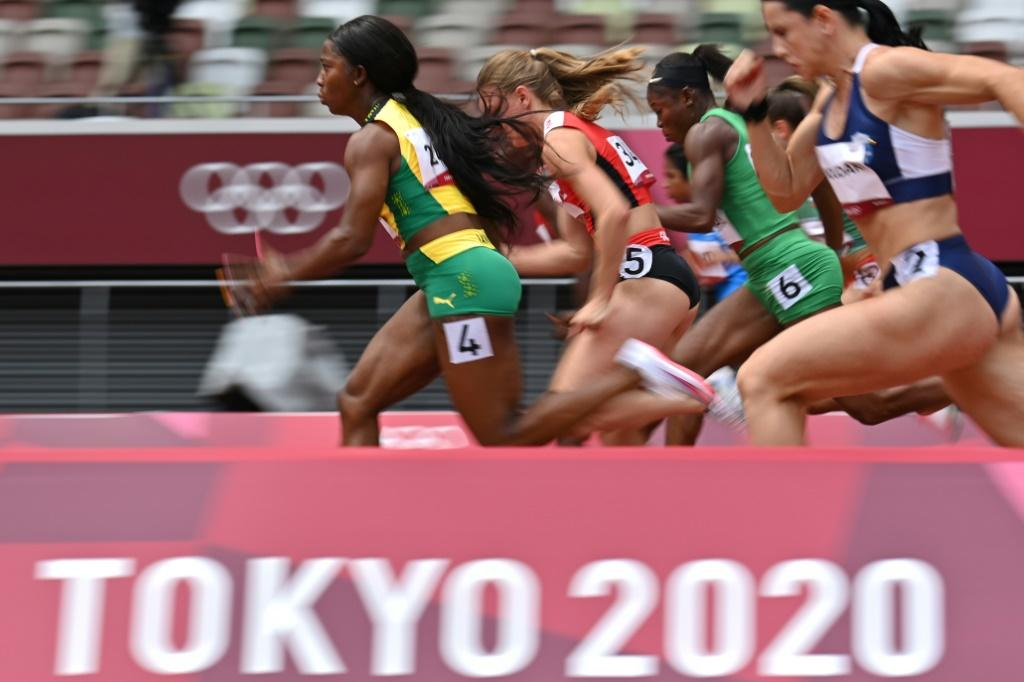 Jamaica's Shelly-Ann Fraser-Pryce (L) competes in the women's 100m heats