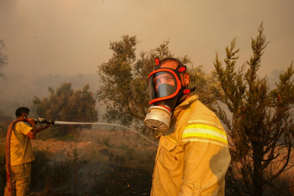 The government said 57 of the 71 fires had been contained or entirely put out by Friday morning