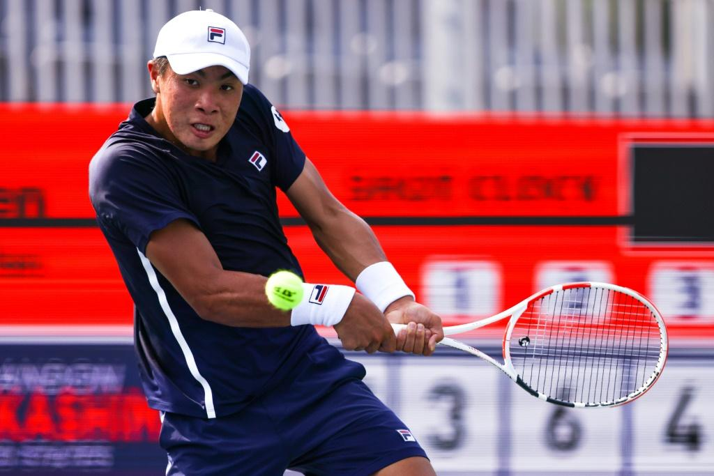American Brandon Nakashima looks to return a shot from Emil Ruusuvuori of Finland during a match at the Atlanta Open