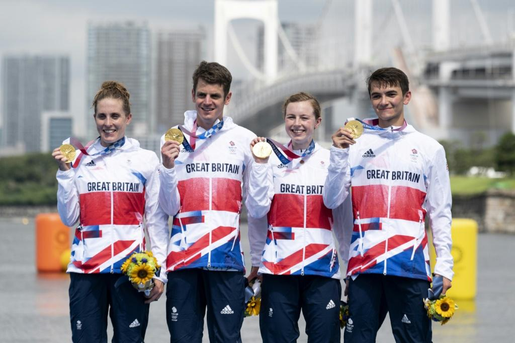 Jonathan Brownlee (second left) finally won a triathlon gold after winning the mixed race with Alex Yee, Georgia Taylor-Brown and Jessica Learmonth