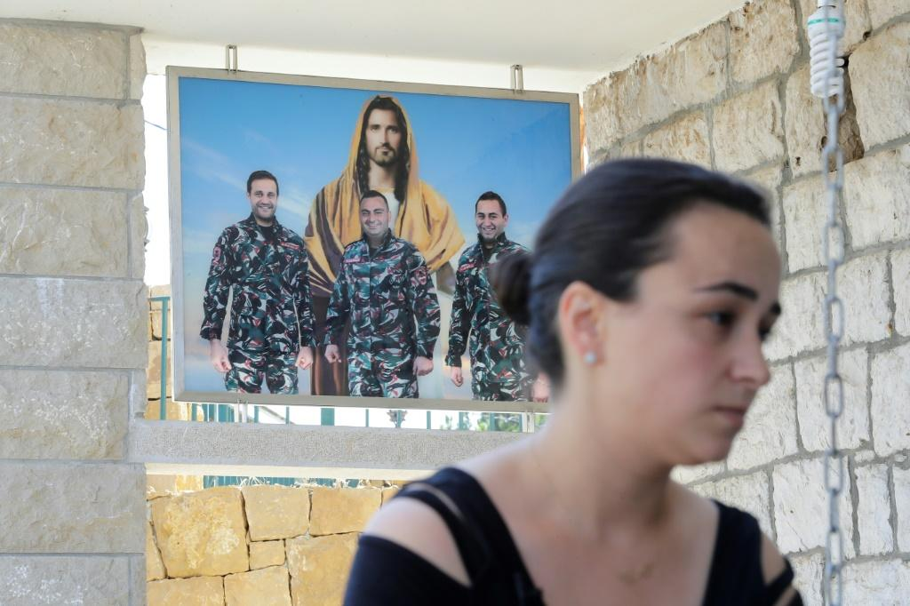 Karlen Hitti Karam's husband, brother and cousin -- pictured behind her -- were firefighters killed in the Beirut blast that claimed 214 lives