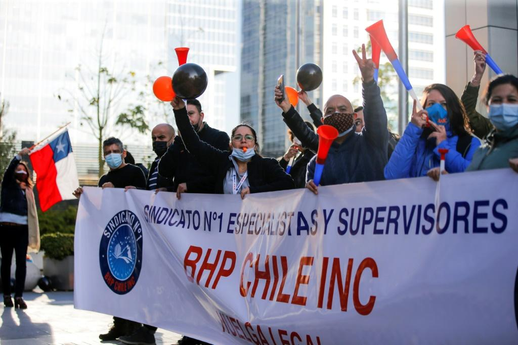 Workers of the Escondida copper mine protest during a strike outside BHP Billiton's offices, in May