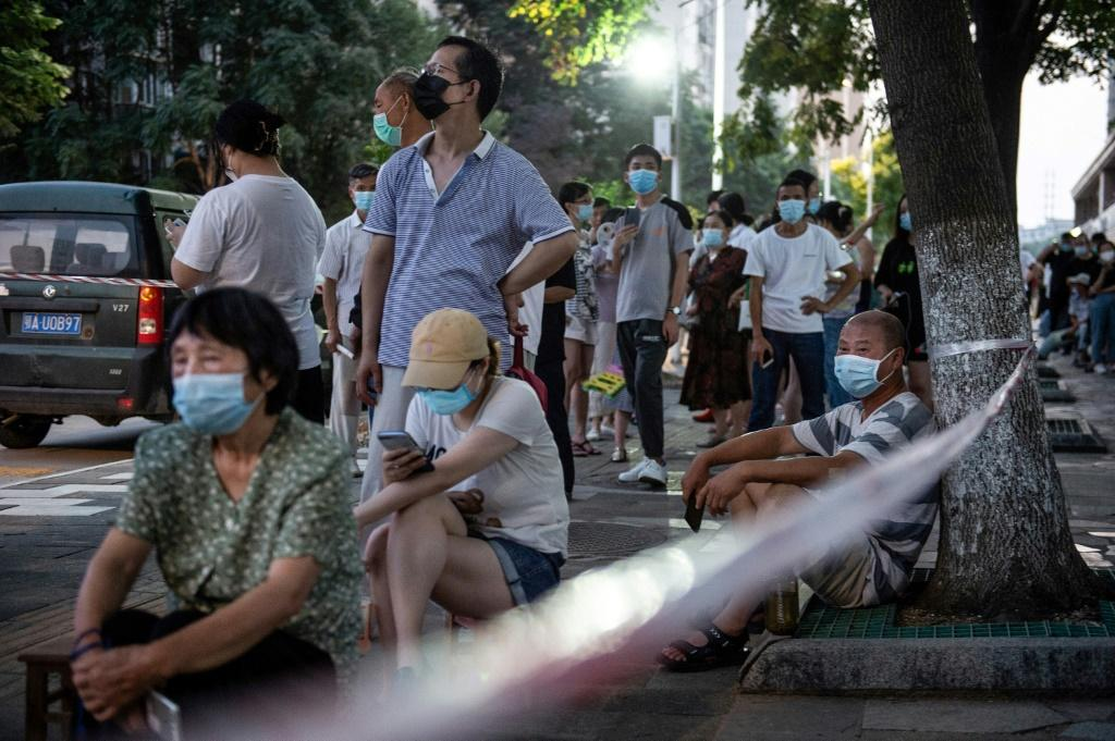 Wuhan residents waited in long lines in the summer heat to get tested for the virus