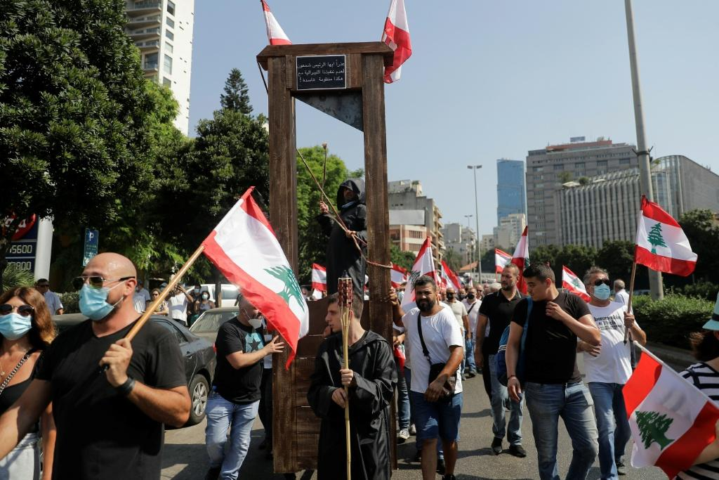 Demonstrators in the Lebanese capital march with a guillotine device
