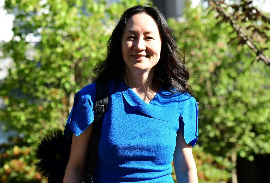 Huawei's chief financial officer Meng Wanzhou smiled as she left her residence in Vancouver for a new round of court hearings over a US extradition request