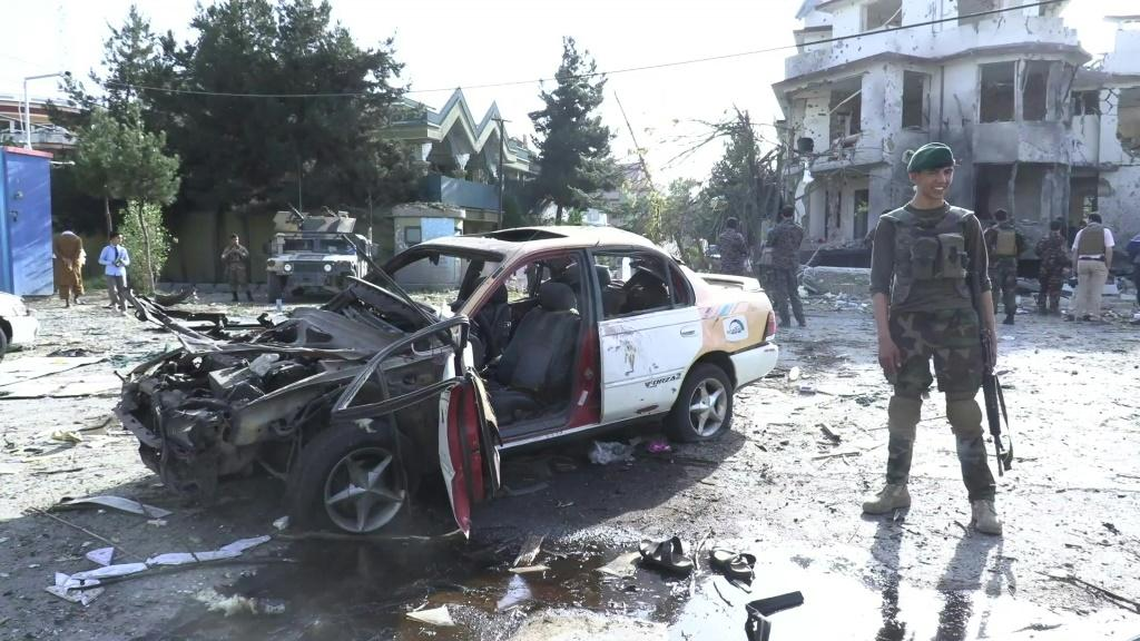 IMAGES Security sources on the scene the morning after a coordinated bomb and gun attack targeting the Afghan defence minister and several lawmakers in the country's capital, not far from the heavily fortified Green Zone.