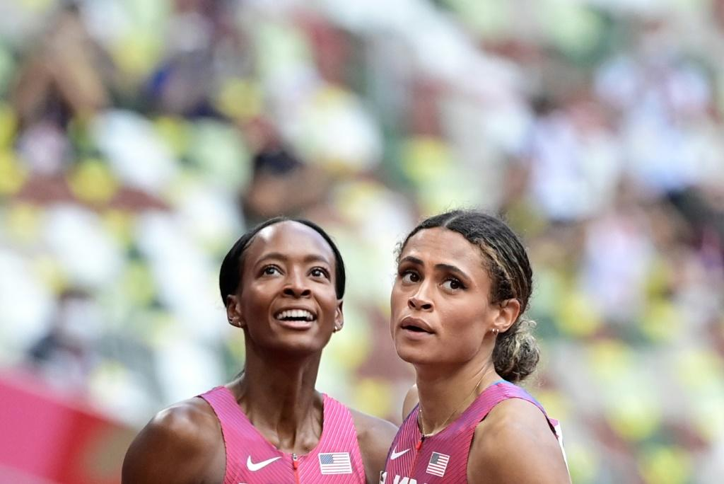 Sydney McLaughlin (right) beat US rival Dalilah Muhammad in the final of the women's 400m hurdles, setting a new world record