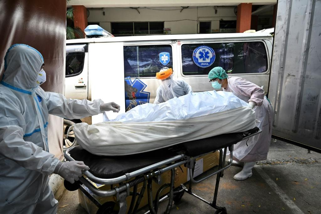 At Thammasat University Hospital, north of Bangkok, staff have had to rent a special container to store bodies after the morgue filled up