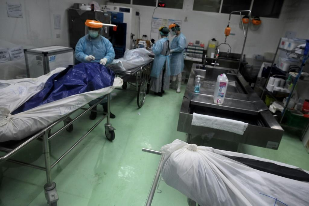 Every body that arrives at the morgue has to be swabbed for Covid-19 by staff swathed in head-to-toe protective suits and face masks and shields