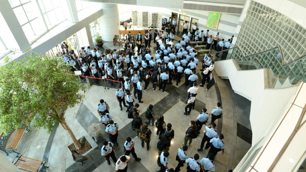 Hong Kong Police raid the offices of pro-democracy newspaper Apple Daily in June 2021