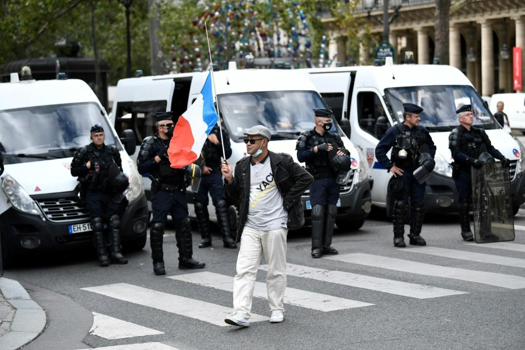 """Protesters in Paris on Thursday chanted slogans """"libery, liberty"""" and """"Macron, we don't want your pass"""