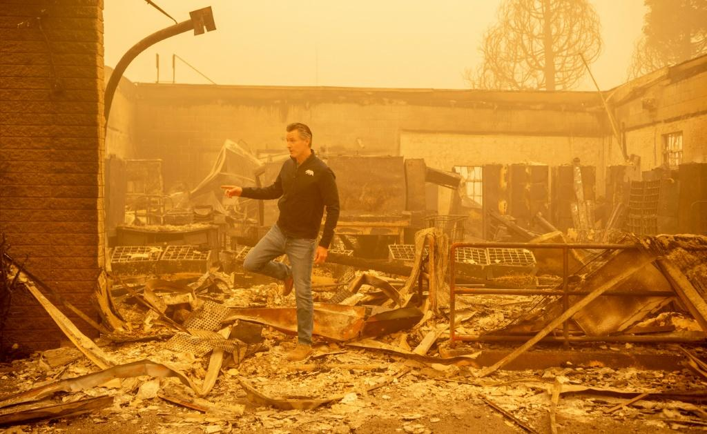 California Governor Gavin Newsom surveys a United States Post Office that burned down in downtown Greenville in the Dixie fire -- now the state's second-largest ever