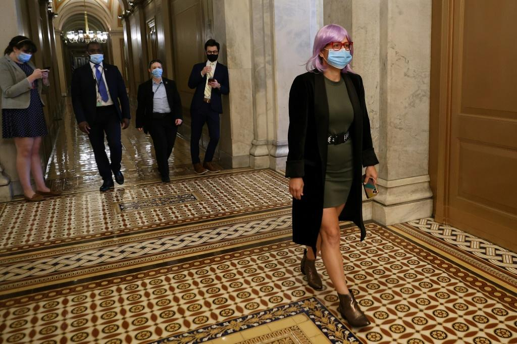 Kyrsten Sinema leaves the US Capitol following a vote in May