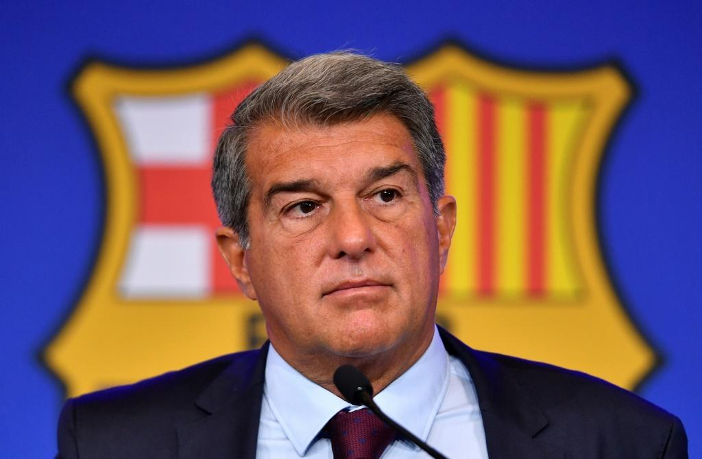Facing a tricky future: Cub president Joan Laporta laid Barcelona's problems at a press conference